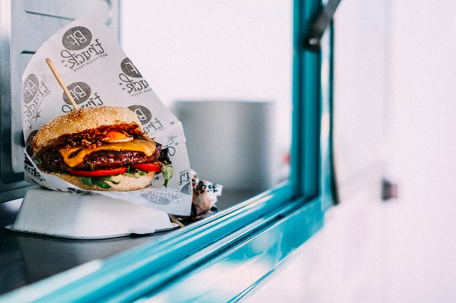 hamburger in window of food truck to go
